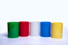 Colorfull shiny Plastic cup for pencil - Stock Image Stock Photos