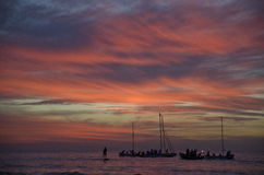 Colorfull sunset. On the beach of Herzlia, Israel, while people enjoy the sea on the end of the day, on boats stock images