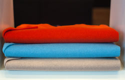 Colorfull sweaterin the clothes shop Stock Photos