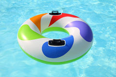Colorfull swim ring. Floating on a blue swimming pool Royalty Free Stock Photos