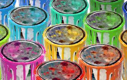 Colorfull tins metal paint. Background of isolated group of rusty tins metal paint stock photo