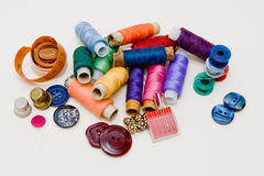 Colorfull tread, buttons and needle Royalty Free Stock Photography