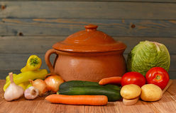 Colorfull vegetables and a ceramic pot Royalty Free Stock Photography