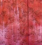 Colorfull vibrant outdoor bumpy brick red color perspective vintage wall. Texture royalty free stock photo