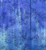 Colorfull vibrant outdoor bumpy deep blue color perspective vintage. Wall texture royalty free stock photography