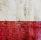 Colorfull vibrant outdoor bumpy red vintage wall texture background. Red and white stock image
