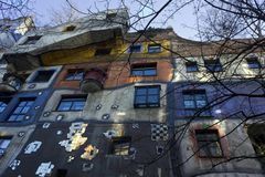 The colorfully decorated facade of Hundertwasser House. VIENNA, AUSTRIA - DECEMBER 31 2016: The colorfully decorated exterior facade of Hundertwasser House in Stock Photo