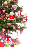 Colorfully decorated isolated Christmas tree with red decoration Stock Photos