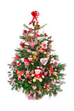 Colorfully decorated isolated Christmas tree with red decoration Royalty Free Stock Images