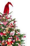 Colorfully decorated isolated Christmas tree with red decoration Royalty Free Stock Image