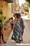 Colorfully dressed women in the streets in senegal Royalty Free Stock Photo