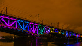 Colorfully illuminated railway bridge Royalty Free Stock Photography