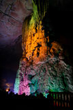 Colorfully lit stone formations in cave at guilin Royalty Free Stock Photos