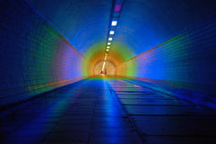 Colorfully lit tunnel Stock Photo