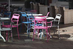 Colorfully metal chairs. And white tables Royalty Free Stock Images