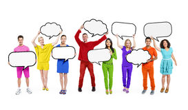 Colorfully Multi-Ethnic People in a Row Stock Images