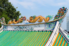 Colorfully Painted Roof Sculptures of Dragons on a Chinese Templ Royalty Free Stock Image