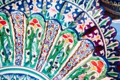 Colorfully painted Uzbek national dishes Stock Images