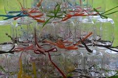 Colorfully staplade Mason Jars Royaltyfria Bilder