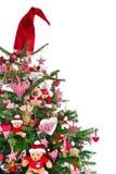 Colorfully verfraaide geïsoleerde Kerstboom met rode decoratie Royalty-vrije Stock Afbeelding
