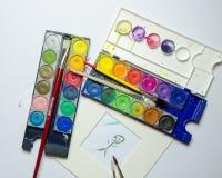 Colori di acqua con l'immagine e le spazzole Fotografia Stock