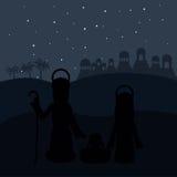 Colori il fondo nella notte del deserto di Betlemme con vergine Maria e St Joseph e Gesù in greppia Immagine Stock