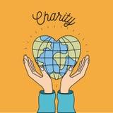 Colori le mani del fondo di immagine con il mondo del globo del terreno mobile nel simbolo della carità di forma del cuore Immagine Stock Libera da Diritti