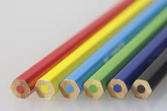 Colori le matite Bugia adiacente ad a vicenda ad angolo Immagine Stock Libera da Diritti