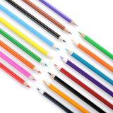 Colori le matite isolate sulla fine bianca della priorità bassa in su fotografie stock