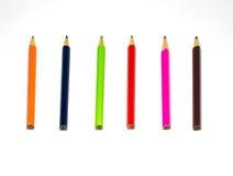 Colori le matite isolate sulla fine bianca della priorità bassa in su Immagine Stock