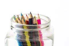 Colori le matite isolate sulla fine bianca della priorità bassa in su Immagine Stock Libera da Diritti