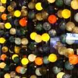 Colorido bobbles illuminado en la ventana Imagen de archivo