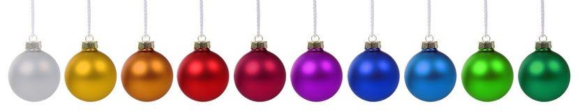 Colorido das quinquilharias das bolas do Natal em seguido isolado no branco Imagem de Stock