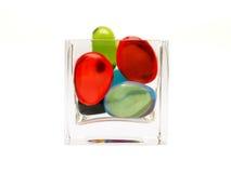 Colorido pebbled en el vidrio Fotografía de archivo libre de regalías