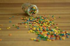 Colorido polvilha derramado em um contador foto de stock royalty free