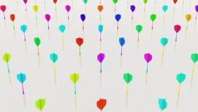 Colorido variamente jogando dardos mesmo em uma grade apertada em uma superfície concreta simples Fotografia de Stock Royalty Free