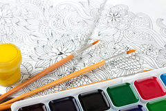 Coloring antistress. Colorer - antistress with colored pencils and watercolor brushes Royalty Free Stock Image