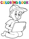 Coloring book boy playing with tablet Stock Photography