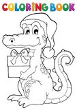 Coloring book Christmas crocodile. Eps10 vector illustration Royalty Free Stock Images