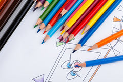 Coloring book and colored pencils. With partially colored picture Stock Photography