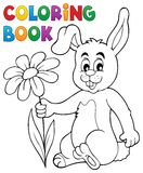 Coloring book Easter bunny with flower Stock Image