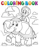 Coloring book man travelling on elephant Stock Photography