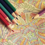 The coloring book with pencils. The coloring book for adults hobby with pencils Royalty Free Stock Photo