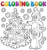 Coloring book penguins by Christmas tree Stock Photography