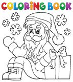 Coloring book with Santa Claus and gift Stock Photos