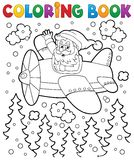 Coloring book Santa Claus in plane Stock Images