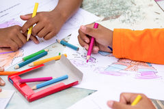 Coloring. Children playing coloring games in Thailand Royalty Free Stock Photos