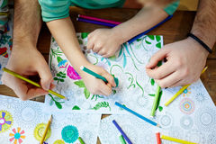 Coloring with crayons Stock Images