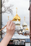 Coloring of dome of russian church in autumn. Travel concept - hand paints by painbrush golden dome of russian church in autumn Stock Photography