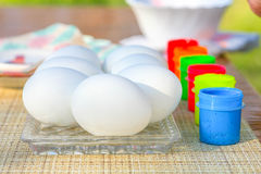 Coloring Easter egg. S on the table Royalty Free Stock Images